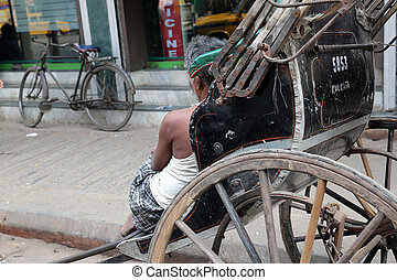 Rickshaw driver working on February 15, 2014 in Kolkata,...