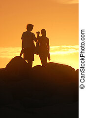 COUPLE SILHOUETTE - Romantic couple watching the sunset