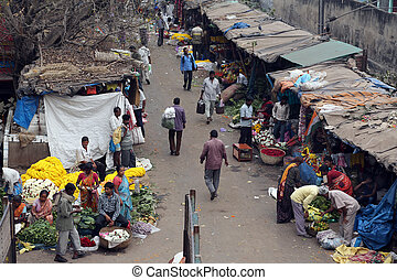 Kolkata flower market - People buying and selling flowers...