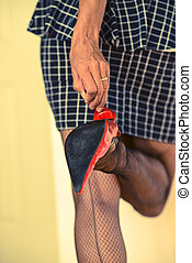 Fishnet legs with red high heel
