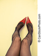 Womans legs in fishnet stockings - Long attractive female...