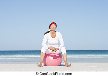 Active retirement mature woman at beach