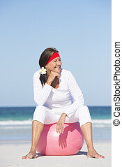 Woman enjoying active retirement at beach