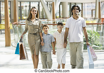 Family shopping in mall