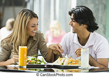Couple enjoying lunch at cafe - Couple enjoying lunch...