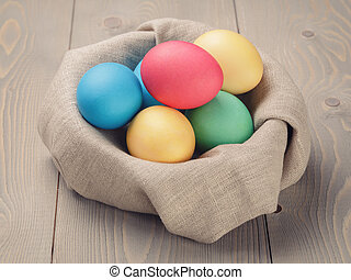 easter eggs in nest from sack textile rustic style, vintage...