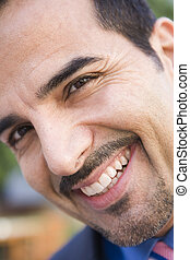 Close-up of smiling businessman looking to camera