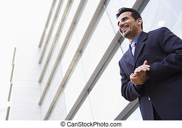 Businessman standing outside office building