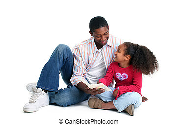 Father Daughter Reading - Attractive African American father...