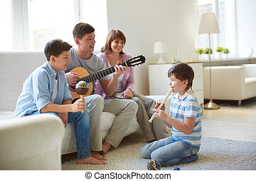 Musical family - Portrait of handsome siblings and their...