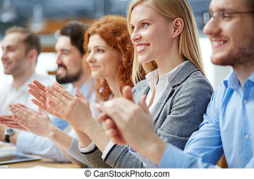 At conference - Photo of happy business people applauding at...