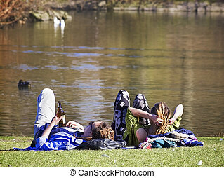 couple relaxing at water's edge