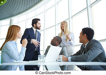 Debates - Group of business partners looking at their boss...