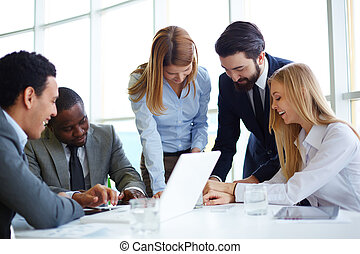 Business partners communicating - Group of business partners...
