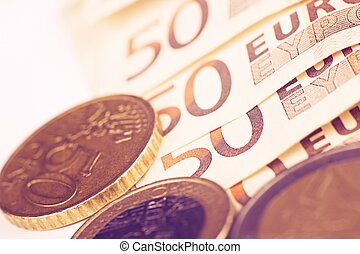 European Euro Currency 50 Euros Bills and Some Coins Closeup...