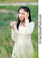 Beautiful Asian woman enjoy nature meadow.