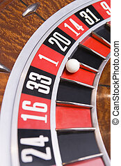 Close up of ball on roulette wheel with ball in number one...