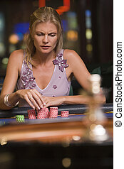 Woman concentrating at roulette table