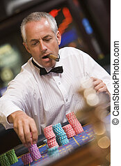 Man placing bet at roulette table