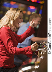 Woman winning on at slot machine - Woman celebrating win on...