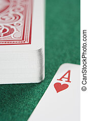 Deck of cards with ace - Deck of cards on green baize with...
