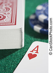 Deck of cards and chips with ace of hearts - Deck of cards...