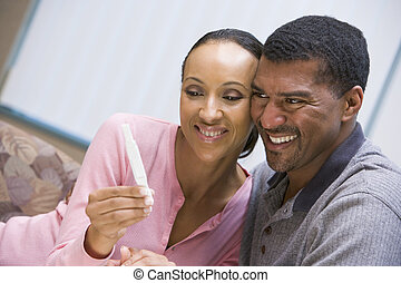 Couple with home pregnancy test - Couple with positive home...