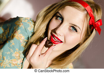 eating chocolate beautiful blonde pinup young woman girl...