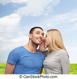 smiling girlfriend telling boyfriend secret - relationships,...