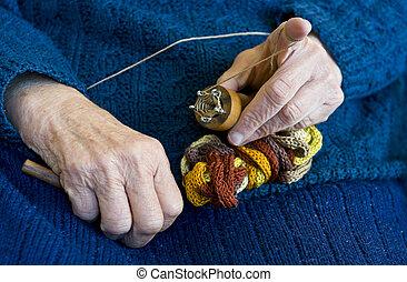 Hand knitting.