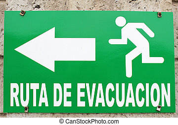 Evacuation Route Sign - A green sign indicating an...