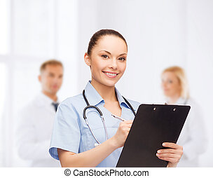 smiling female doctor or nurse with stethoscope - healthcare...