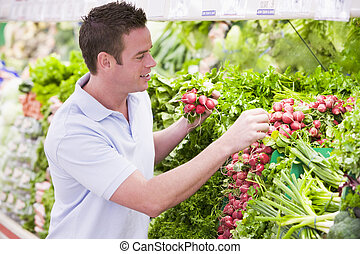 Man shopping in produce department