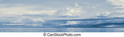 Rain Clouds Panorama at the Sea Horizon