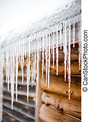 Long Icicles Melting of a roof top - Long Icicles Melting of...
