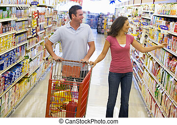 Couple shopping in supermarket - Couple in shopping in...