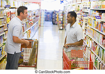 Two men meeting in supermarket - Two men meeting and talking...