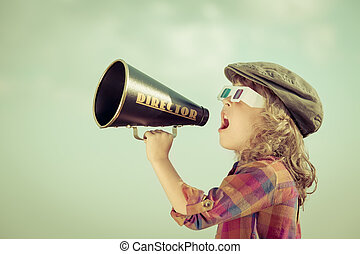 Kid shouting through megaphone - Kid shouting through...