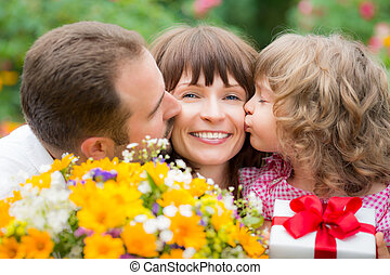 Mother's day greeting - Happy family with bouquet of flowers...