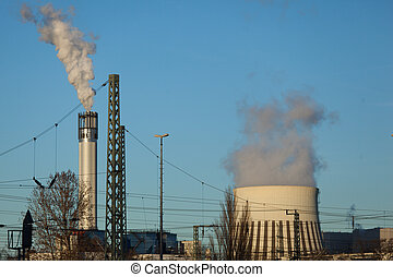 two power plant towers with smoke in Berlin