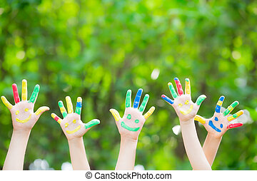 Smiley hands - Group of smiley hands against green spring...