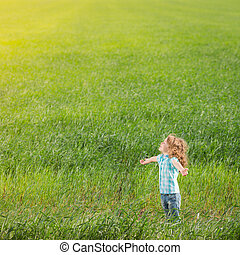 Child in spring field - Happy child outdoors in spring field