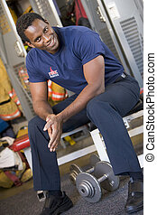 Portrait of a firefighter in the fire station locker room
