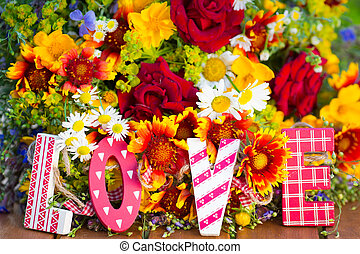 Spring flowers and wooden letters LOVE