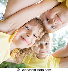 Low angle view portrait of happy children - Unusual low...