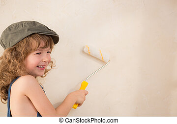 Kid painting wall. Renovation concept