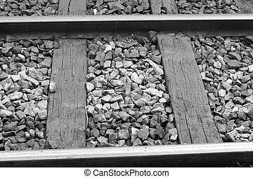 closeup of photo, rusty rails in train station