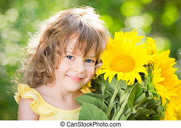 Mother`s day - Happy child with bouquet of flowers against...