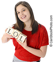 LOL - A pretty young teen happily holding rustic alphabet...