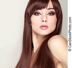 Fashionable female model with long hair and bright makeup...